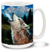 A howling wolf bays in the mountain twilight. Vivid, close-up view of a majestic wolf during a full moon. 15oz coffee mug