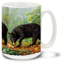 These cute little bear cubs are looking for fun and mischief.