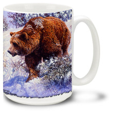 A beautiful Grizzly Bear in a Winter Wonderland.