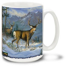 The beautiful Mule Deer in the snowy wilderness.