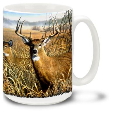Majestic deer in a grassy field.