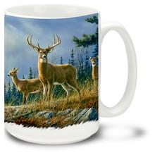 Beautiful deer against a pine tree backdrop.