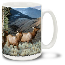 Majestic Elk against mountains & trees.