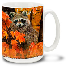 Cute Raccoons surrounded by fall leaves.