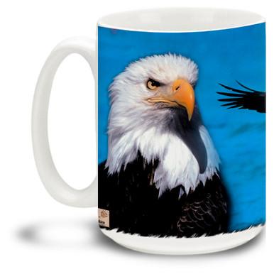 Beautiful Eagle against an ocean blue background.