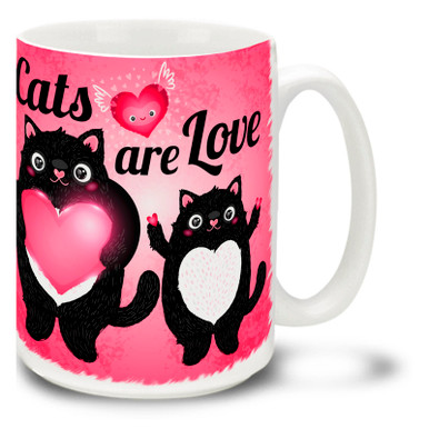 "Get all warm and fuzzy with this charming, cat mug that tells it like it is! 15oz ""Cats Are Love"" cat mug is durable, dishwasher and microwave safe."