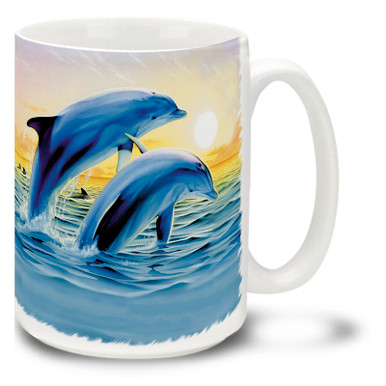 Colorful jumping dolphins mug features bright sunset colors. Jumping Dolphins Coffee Mug is dishwasher and microwave safe.
