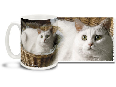 A plush and fluffy white kitty makes the perfect fashion accessory, unless you're wearing black! Sip your java from a pretty white kitty cat mug. Fluffy white kitty cat coffee mug is durable, dishwasher and microwave safe.
