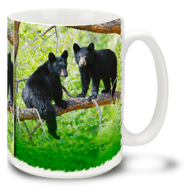"""Black bears prefer forested areas, and these little cubs are having fun exploring their surroundings! Climb out of bed in the morning with this black bear cub coffee mug. 15oz Black Bear Cub coffee mug is durable, dishwasher and microwave safe. Have yourself a """"cub"""" of coffee!"""