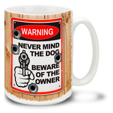 Tell it like it is with this Warning: Never Mind the Dog Beware of the Owner gun coffee mug complete with bullet holes. Fetch me my bullets, Fido! Fun Warning Sign gun mug is dishwasher and microwave safe.