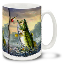 Featuring a vivid image of a Large Mouth Bass chasing a jig at daybreak, this Bass Fishing Coffee Mug is a realy eye opener! This colorful Bass Fishing Mug is dishwasher and microwave safe and celebrates fishing mug holds 15oz. of your favorite coffee.