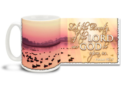 "Enjoying a misty, rose-colored morning with the ducks with this beautiful Christian Inspiration coffee mug featuring the popular passage from Psalm 90:17 ""Let the Beauty of the Lord our God be upon us"". 15 oz Psalm 90:17 Inspirational Coffee Mug features a colorful sunrise on a pure and unspoiled lake and is dishwasher and microwave safe."