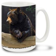 An American black bear enjoys a relaxing break in the wilderness on this black bear coffee mug. 15oz Bear Mug is dishwasher and microwave safe.