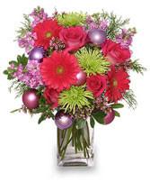 Send some Seasonal Style with this wonderfully festive Holiday Vased Flower Arrangement