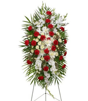 "54"" easel stand large wet floral foam cage foliage: teepee, leather leaf 24 red carnations 8 white Fuji mums 4 stems white cushion poms 8 stems white gladiolus 5 stems white waxflowers"