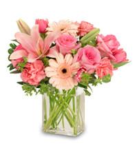 Rectangular Vase Foliage: Pittosporum Peach Or Pale Pink Gerberas Pink Carnations Pink Roses Pink Tulips Pink Lilies Bupleurum