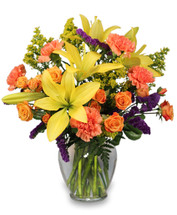 "7 1/4"" ginger vase foliage: leather leaf, variegated pittosporum orange miniature spray roses   yellow lilies orange carnations  purple statice  solidago"