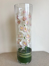 Beautiful 20 inch cylinder vase, with large stem of white cymbidium orchid and a aspidistra leaf