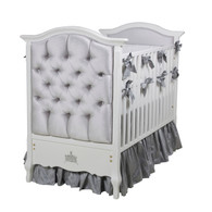 Bordeaux Crib Finish: Snow Fabric: AFK Majestic Silver Tufting Option: Crystal Tufting Appliquéd Moulding Option: Crown Moulding in Silver Gilding