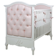 Bordeaux Crib Finish: Antico White Fabric: AFK Brook Pink Tufting Option: Button Tufting Appliquéd Moulding Option: Cherub