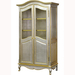 Grand Armoire Finish: Silver Gilding Trim Out: Gold Gilding Door Option: Brass Wire Mesh Knobs: Glass Knobs with Gold Base and Florets in Gold Gilding