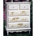 French Tall Chest Finish: Antico White Trim Out: Brown Gingham Hand Painted Motif: Toile Brown Knobs: Glass Knobs with Gold Base