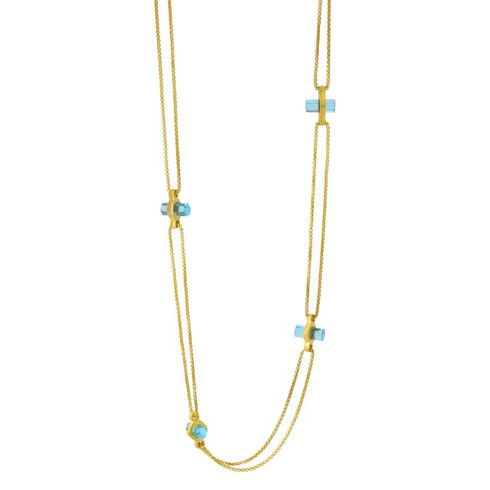 Multi-faceted, brilliant-cut gemstone paired with brushed gold disc