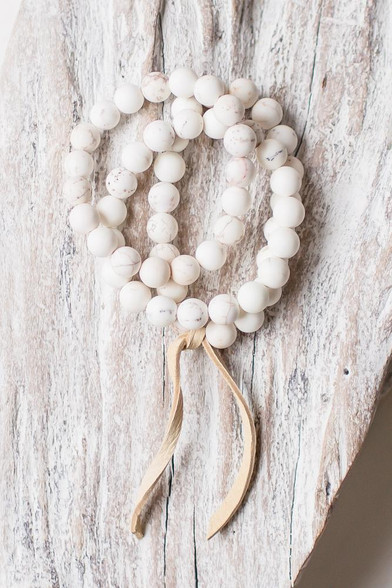 3 stretchy creamy white bracelets