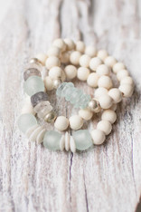 white wooden bracelets with a mix of recycled glass beads
