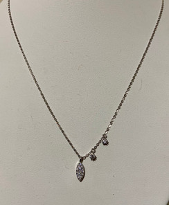 Sterling silver necklace set with cubic zirconia.