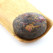 Its rich rose flavor comes through after the pu-er tea has been infused with rose petals.