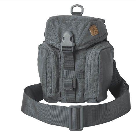 Helikon-Tex Essential Canteen Kit Bag (Shadow Grey)  The Helikon-Tex Essential Kitbag® was designed to hold all essential bushcraft/survival kit. This bag will hold the Heavy Cover Titanium Canteen & cup, or Nalgene Bottle & cup , folding stove, flashlight, compass, cord, sewing kit etc. All kit is neatly organized in separate pockets. Essential can be carried attached to backpack or belt via MOLLE/PALS or with its own shoulder strap. There is a sleeve on the back that will hold a folding saw/knife/axe. Capacity can be velcro reduced. Extra pouches can be attached at the front side. The Essential Kitbag is an ideal one-day expedition bag to carry all essential stuff.  Features      adjustable buckle closure Takes most 1 liter water bottles (Nalgene, Heavy Cover Titanium & Canteen & cup) Main chamber with adjustable drawstring and compartment for folding expeditionary cooker Zippered mesh water purification tablets pocket inside the flap Side organizer YKK®-zippered pockets with loop and mesh pocket Built in velcro-adjusted sheath for knife/axe/saw Detachable, adjustable wide carrying strap, DUTY BELT/PALS/MOLLE compatible D-rings for strap Co-designed by Survivaltech.pl
