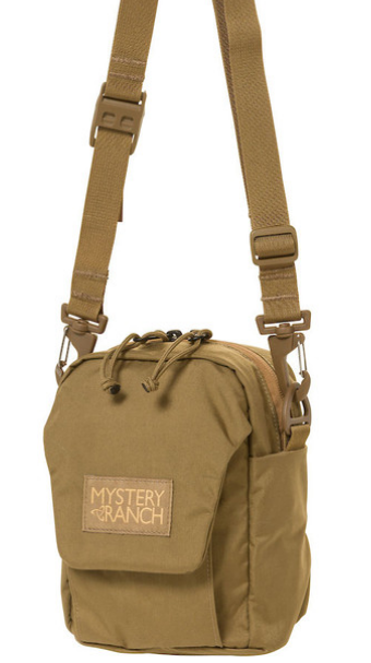 Mystery Ranch Big Bop Canteen/Water Bottle Carrier (Coyote)    Mystery Ranch Big Bop Canteen/Water Bottle Carrier is an essential for every traveler! Originally designed to be worn solely as a shoulder bag, the BIG BOP now expands its options. Shoulder strap, MOLLE attachment to the main pack, or 'biner it to an attachment point of your choice. The interior shines with simplicity, showcasing a single pocket under the protective flap. A one-handed One Drop quick-adjust shoulder strap lets you dial the pack in, one-handed, and on the fly. Features:  Removable one-drop quick-adjust shoulder strap MOLLE on the back for attaching to belt or loop for carabiner One interior pocket Exterior, gusseted front pocket with VELCRO® flap closure. Material:  330 Robic fabric with YKK Zippers.