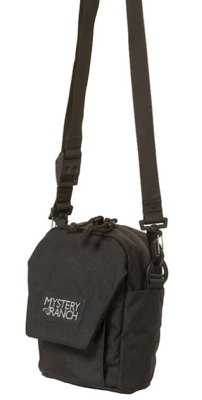 Mystery Ranch Big Bop Canteen/Water Bottle Carrier (Black)     Mystery Ranch Big Bop Canteen/Water Bottle Carrier is an essential for every traveler! Originally designed to be worn solely as a shoulder bag, the BIG BOP now expands its options. Shoulder strap, MOLLE attachment to the main pack, or 'biner it to an attachment point of your choice. The interior shines with simplicity, showcasing a single pocket under the protective flap. A one-handed One Drop quick-adjust shoulder strap lets you dial the pack in, one-handed, and on the fly.          Removable one-drop quick-adjust shoulder strap MOLLE on the back for attaching to belt or loop for carabiner One interior pocket Exterior, gusseted front pocket with VELCRO® flap closure.  330 Robic fabric with YKK Zippers