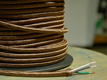 brown round cloth covered 3 wire