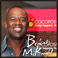 Brian McKnight tasting best gluten free chocolate truffles at the Emmys