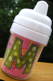 "Picture of the finished insert inside the small sippy cup with the letter ""M"" from our #382 Funky Applique Font set [NOT included]."