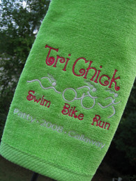 Lime Green towel without grommets stitched with our #490 Tri Chick embroidery design [plus personalization]
