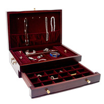 Drawer accommodates 32 compartments sized for earrings, rings, or other small jewelry.
