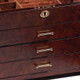 Accented with bright brass drawer pulls, lock and hinges.
