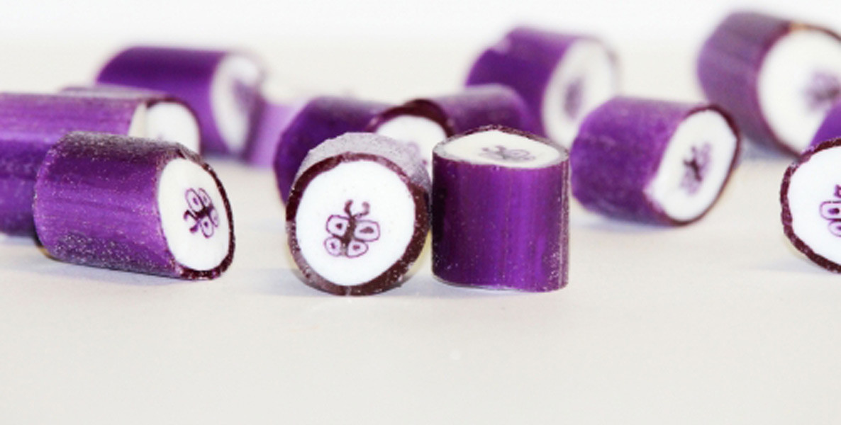 Rock Candy - Purple and White - Butterfly Center, by Designer Candy,  and more Confectionery at The Professors Online Lolly Shop. (Image Number :9102)