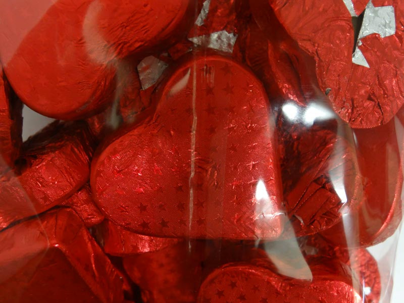 Chocolate Gems - Romeo Hearts - Embossed Red Foil, by Chocolate Gems,  and more Confectionery at The Professors Online Lolly Shop. (Image Number :4395)