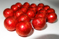 Foiled Milk Choc Red Balls, by Confectionery Trading Company/Niagara,  and more Confectionery at The Professors Online Lolly Shop. (Image Number :5025)