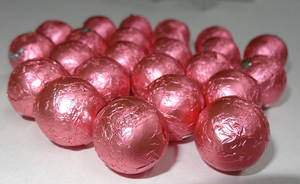 Foiled Milk Choc Bright Pink Balls, by Confectionery Trading Company/Niagara,  and more Confectionery at The Professors Online Lolly Shop. (Image Number :5027)
