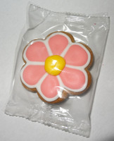 Gingerbread Cookie - Flower - Pink and White with a Yellow Centre, by Krimpis,  and more Snack Foods at The Professors Online Lolly Shop. (Image Number :5440)