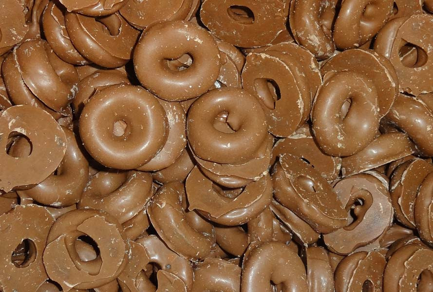 Milk Choc Aniseed Rings, by Colonial Confectionery,  and more Confectionery at The Professors Online Lolly Shop. (Image Number :6825)