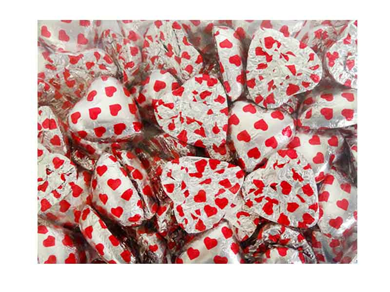 Belgian Milk Chocolate Hearts - Hot Pink Hearts on Silver and more Confectionery at The Professors Online Lolly Shop. (Image Number :12342)