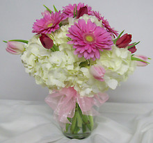 Pretty vase of hydrangea, gerberas and tulips.