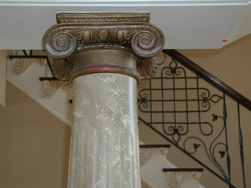 Decorative stair step bracket in plaster adds a design flair