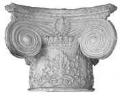This cast column capital features acanthus leaf frieze and large volutes